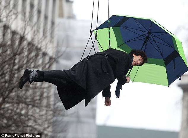 Benedict Cumberbatch as BBC Sherlock hanging in the air holding an umbrella