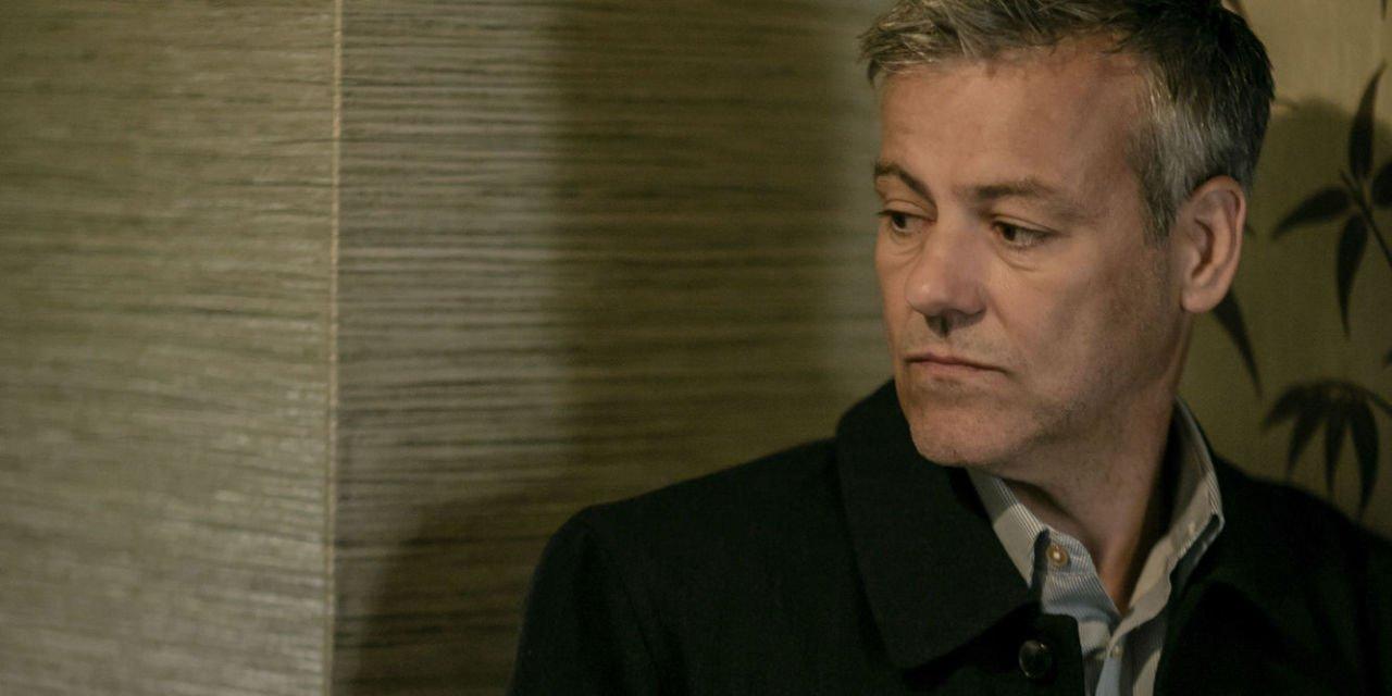 BBC sherlock Inspector Lestrade peering around corner tensely