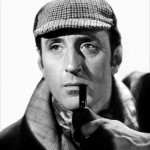 Basil Rathbone as Sherlock Holmes in the deerstalker hat with pipe