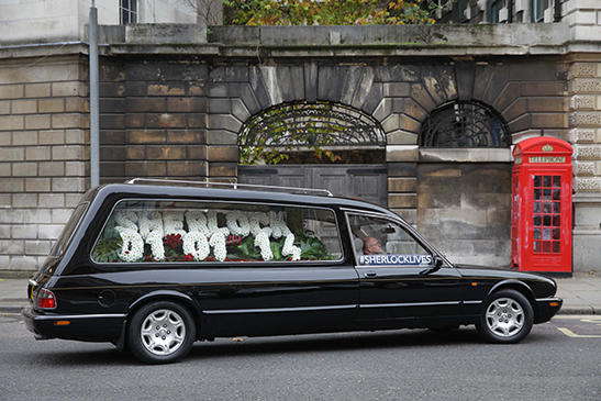 Empty hearse with flowers spelling out 01-01-14, the air date for Sherlock Series 3, Episode 1 in the UK