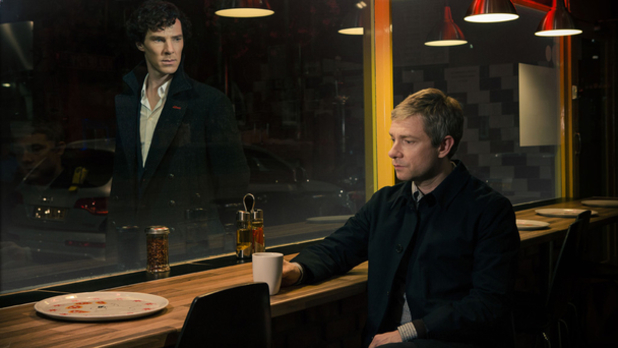 Benedict Cumberbatch as BBC Sherlock looking through cafe window at Martin Freeman as John Watson