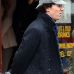 Benedict Cumberbatch as BBC Sherlock in deerstalker and coat with sour frown on his face