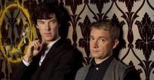 BBC Sherlock Holmes and John Watson leaning beside the Smiley Face wall